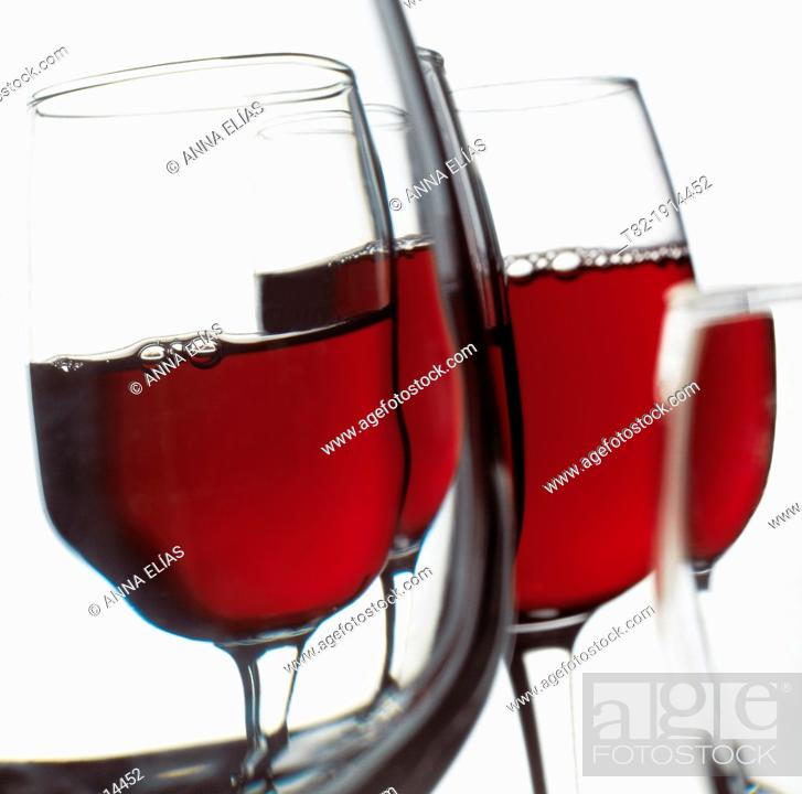 Stock Photo: several bowls full of red wine with hints and deformations.