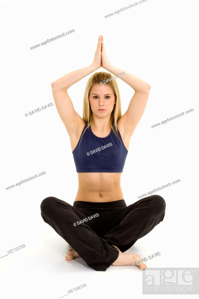 Stock Photo: Woman in early 20s practicing yoga meditation.