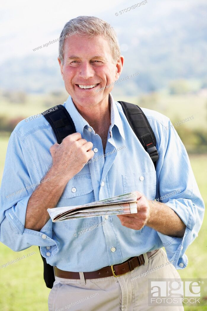 Stock Photo: Senior man on country walk.