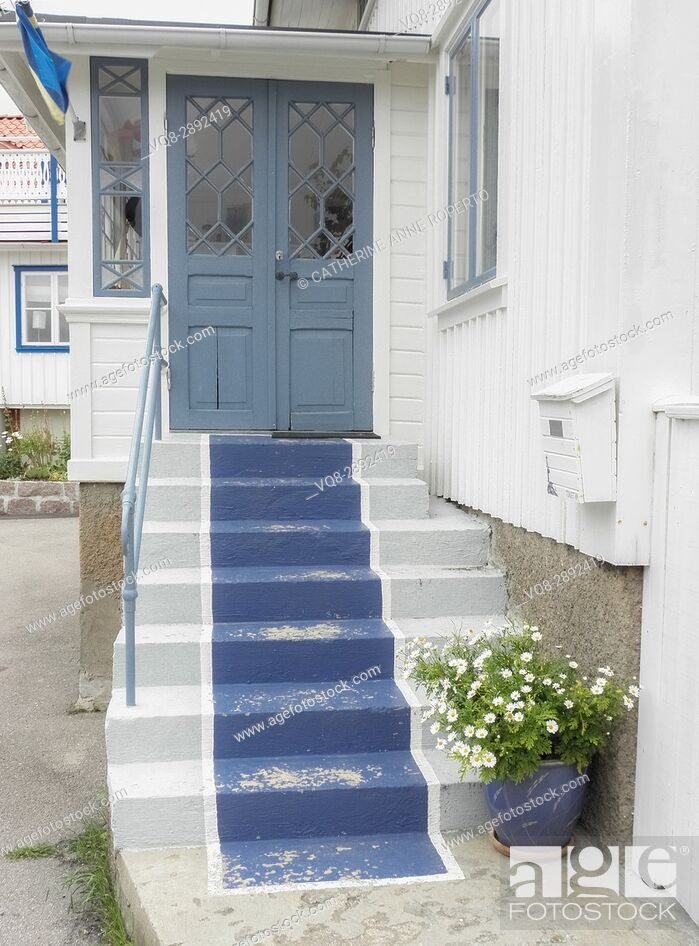 Stock Photo: Blue painted stair carpet on traditional wooden house in coastal conservation area near Gothenburg, Sweden.