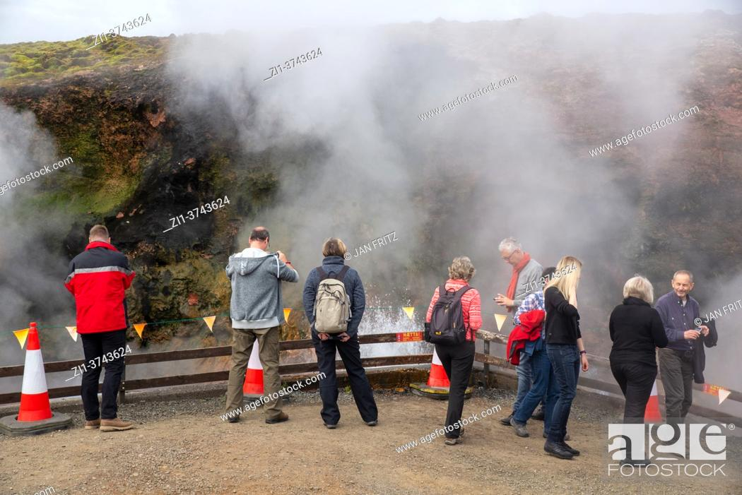 Stock Photo: tourists at hot waterspring at Deildartunguhver at Iceland.