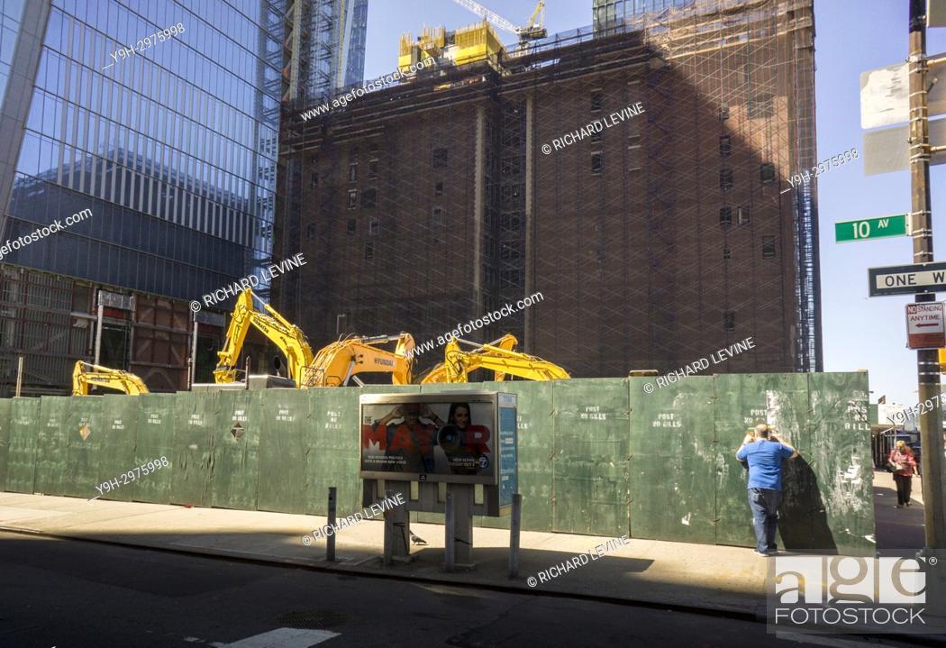 Stock Photo: A sidewalk superintendent inspects Hudson Yards development in New York on Saturday, September 23, 2017. (© Richard B. Levine).