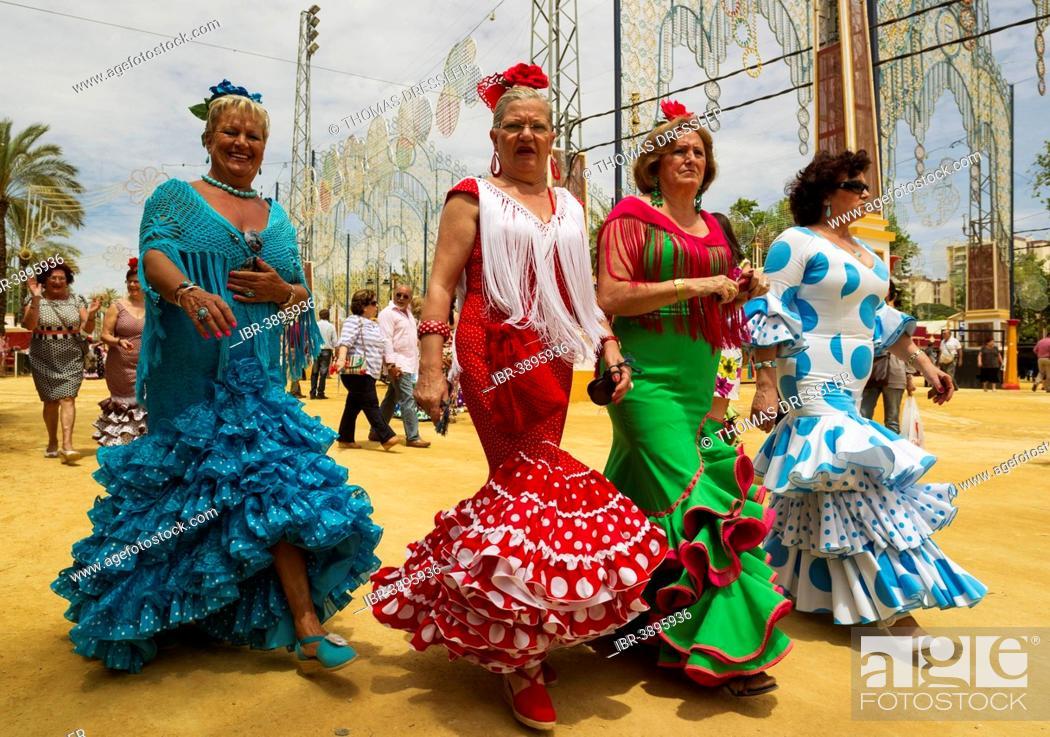 Stock Photo: Women wearing gypsy dresses at the Feria del Caballo, Jerez de la Frontera, Cádiz province, Andalusia, Spain.