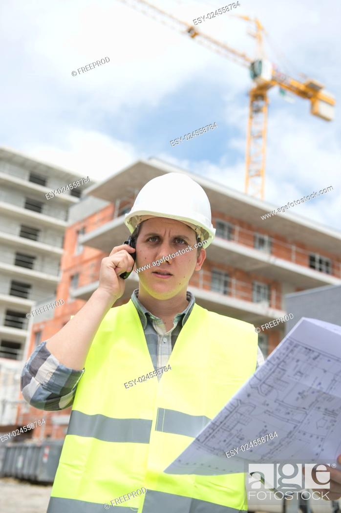 Stock Photo: Construction manager checking construction building project on site.