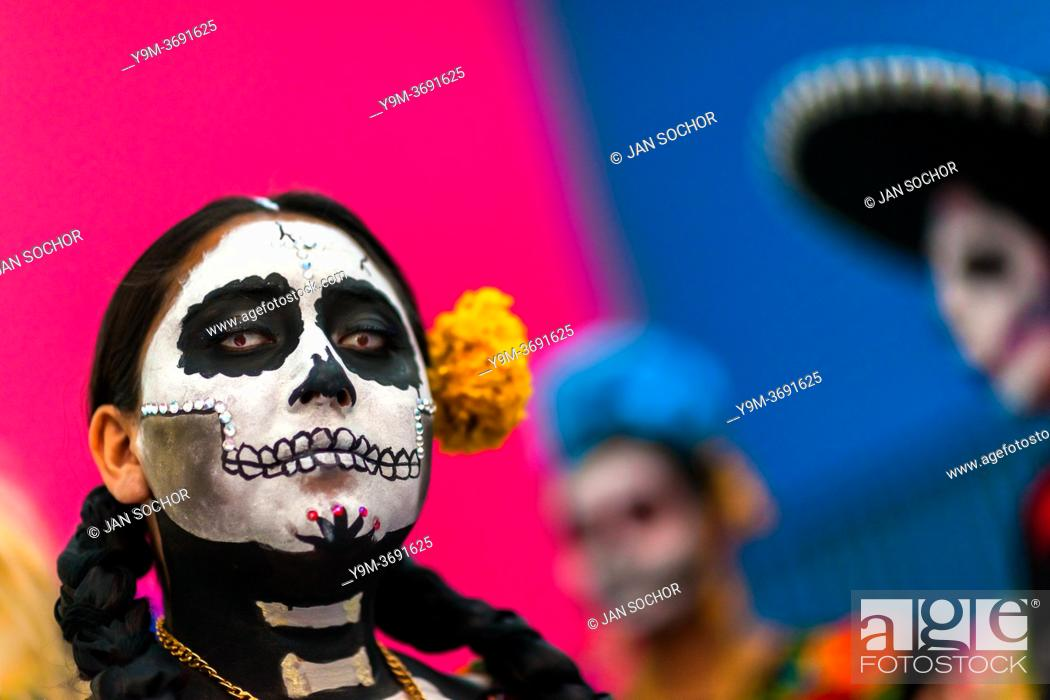 Stock Photo: A young Mexican woman, dressed as La Catrina, a Mexican pop culture icon representing the Death, takes part in the Day of the Dead celebrations in Oaxaca.