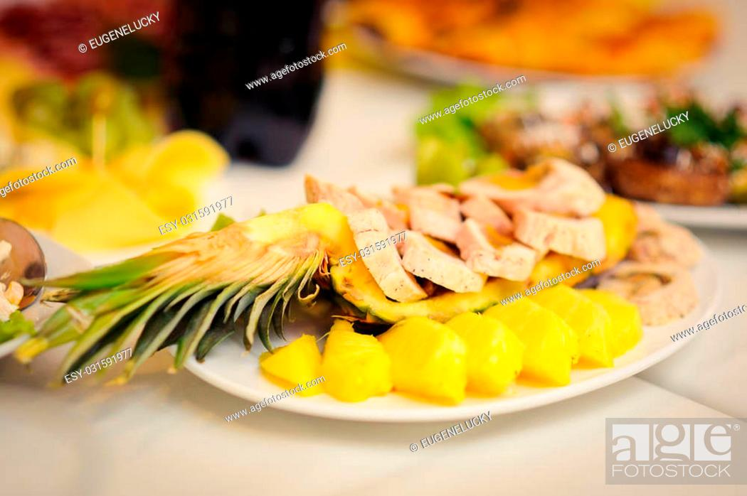 Stock Photo: nice looking and tasty pineapple on wedding reception.