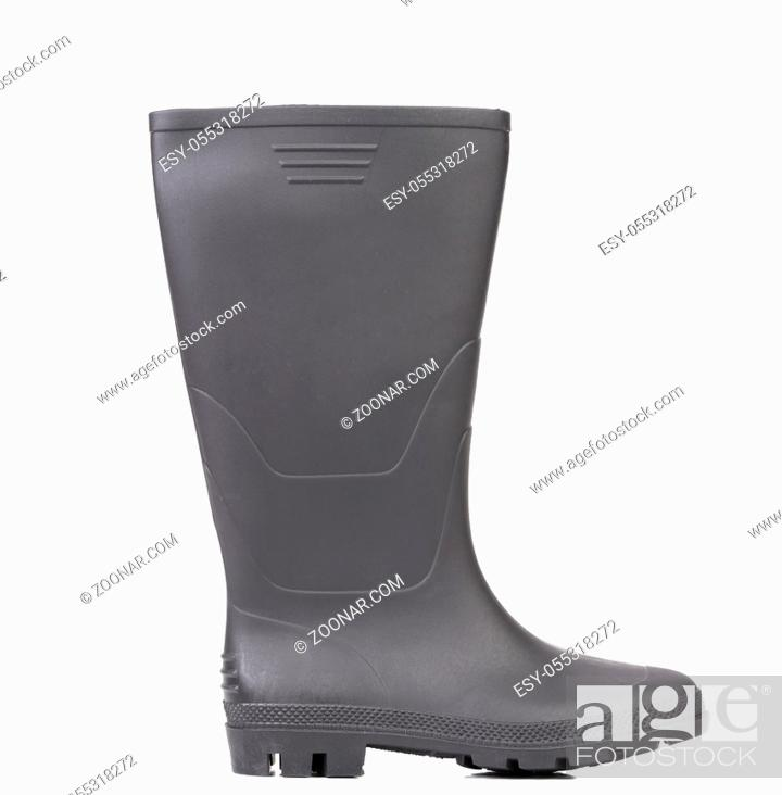 Photo de stock: High rubber boot black color. Isolated on a white background.