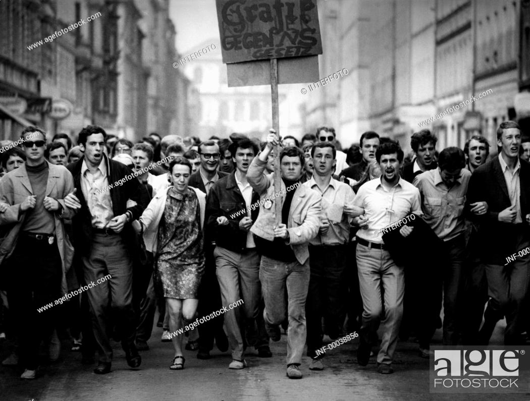 Stock Photo: politics, demonstrations, Germany, protest against emergency laws, students running with banner on the street, Munich, May 1968.,.