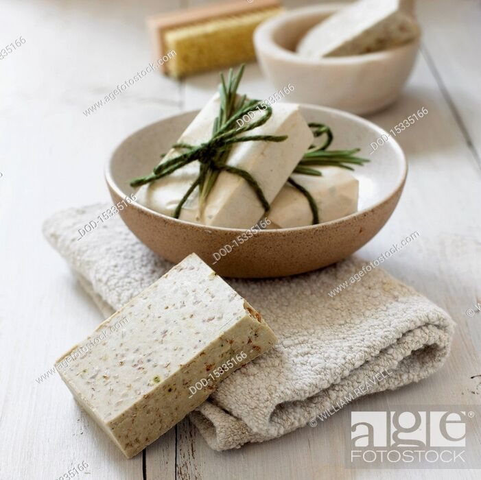 Stock Photo: Rosemary soap in a bowl and on towel, close-up.