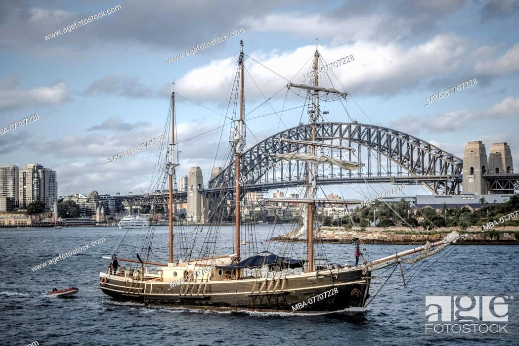 Stock Photo: Sailing ship in front of the Sydney Harbour Bridge, Australia.