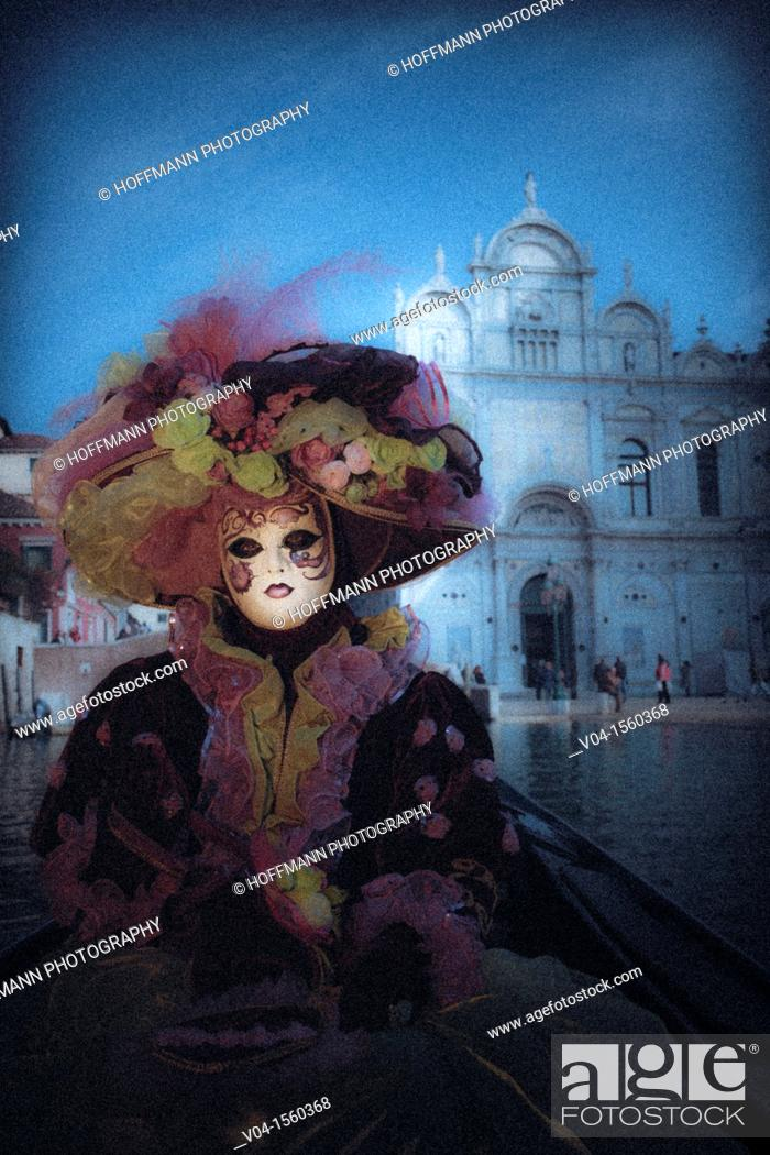 Stock Photo: A mystical view of a masked woman in a gondola at the carnival in Venice, Italy, Europe.