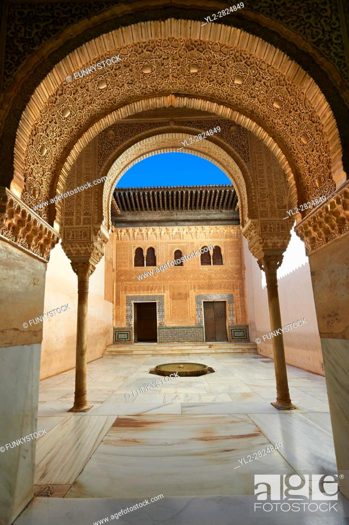 Stock Photo: Arabesque Moorish architecture of an inner courtyard of the Palacios Nazaries, Alhambra. Granada, Andalusia, Spain.