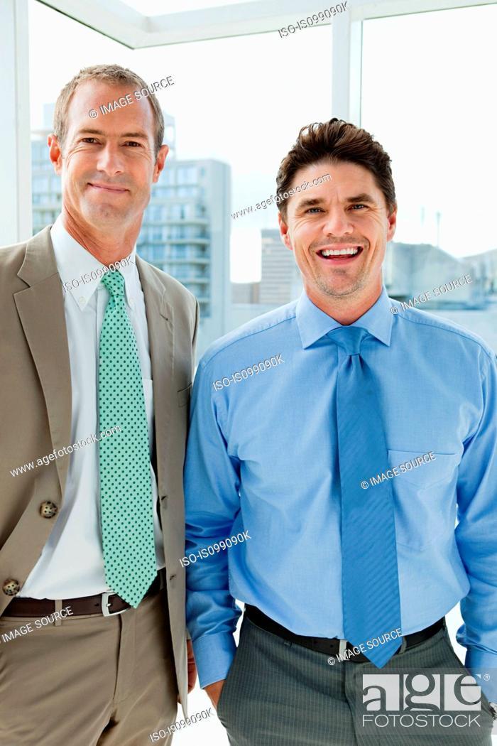 Stock Photo: Two businessmen in office, portrait.