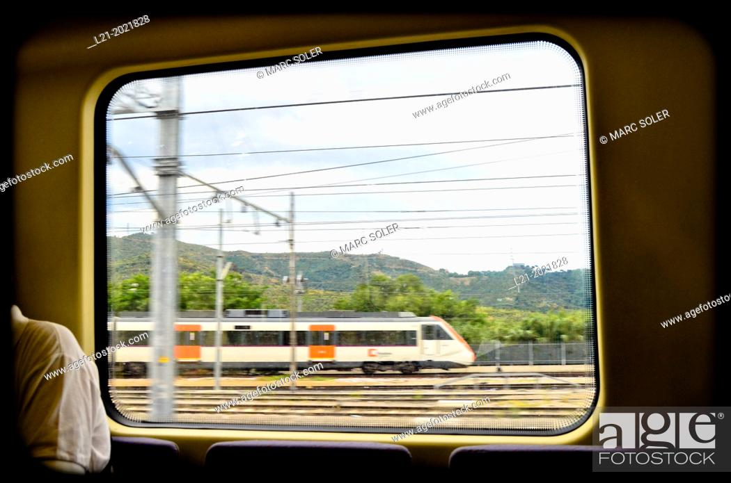 Stock Photo: Vision of a moving train through a window. Barcelona province, Catalonia, Spain.