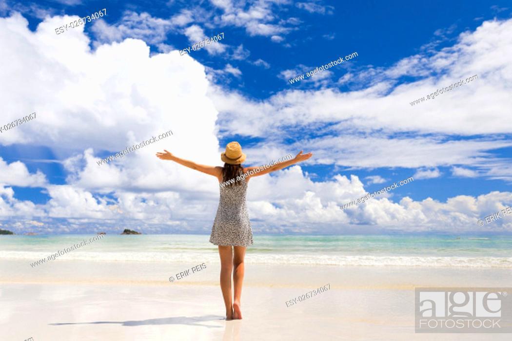 Stock Photo: Beautiful woman walking in the beautiful beach of Praslin, Seychelles.