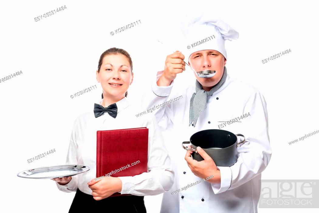 Photo de stock: Cook tastes soup, the waitress holding an empty tray isolated.