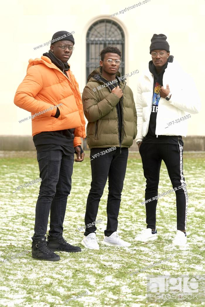 Stock Photo: three male friends together at street, streetwear, youth culture, in city Munich, Germany.