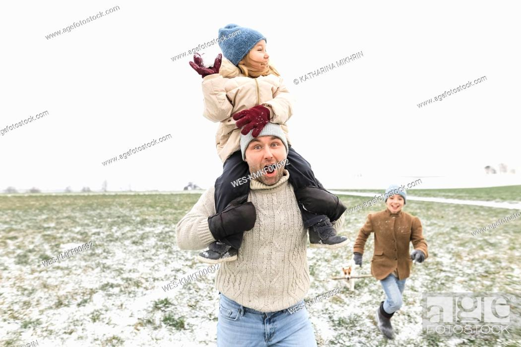 Stock Photo: Happy father with two children in winter landscape.