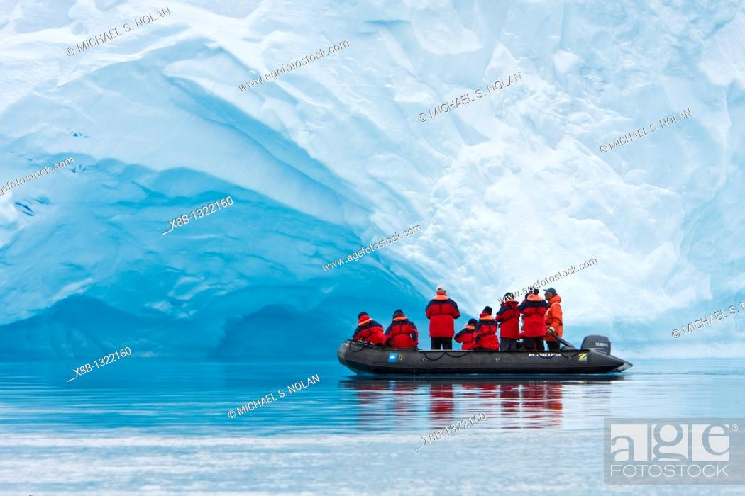 Stock Photo: The Lindblad expedition ship National Geographic Endeavour operating fleet of Zodiacs near icebergs in and around the Antarctic peninsula, Antarctica.
