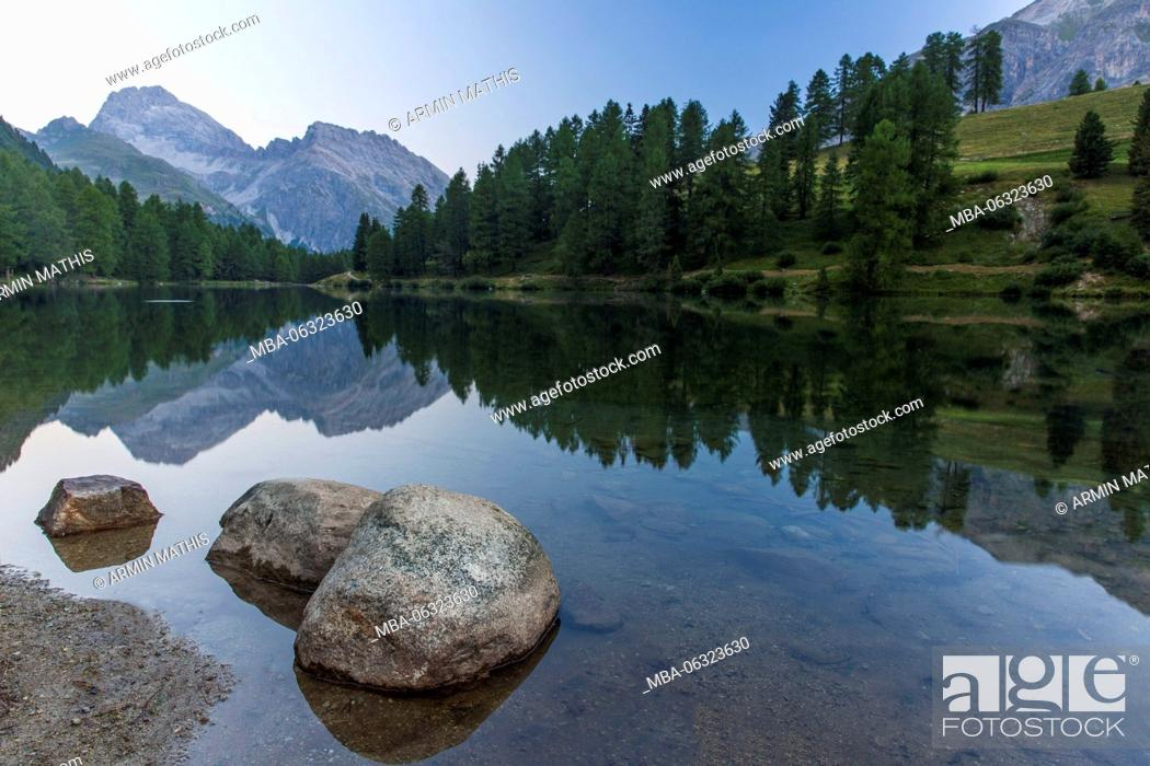 Stock Photo: Morning mood at Lai da Palpuogna, a picturesque lake in Canton of Grisons.