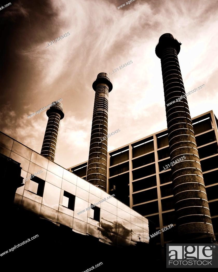 Stock Photo: Three chimneys. Old textile industrial complex, nowadays Fecsa Building. Barcelona, Catalonia, Spain.