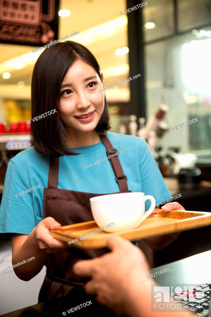 Stock Photo: Cafe waiter and customer.