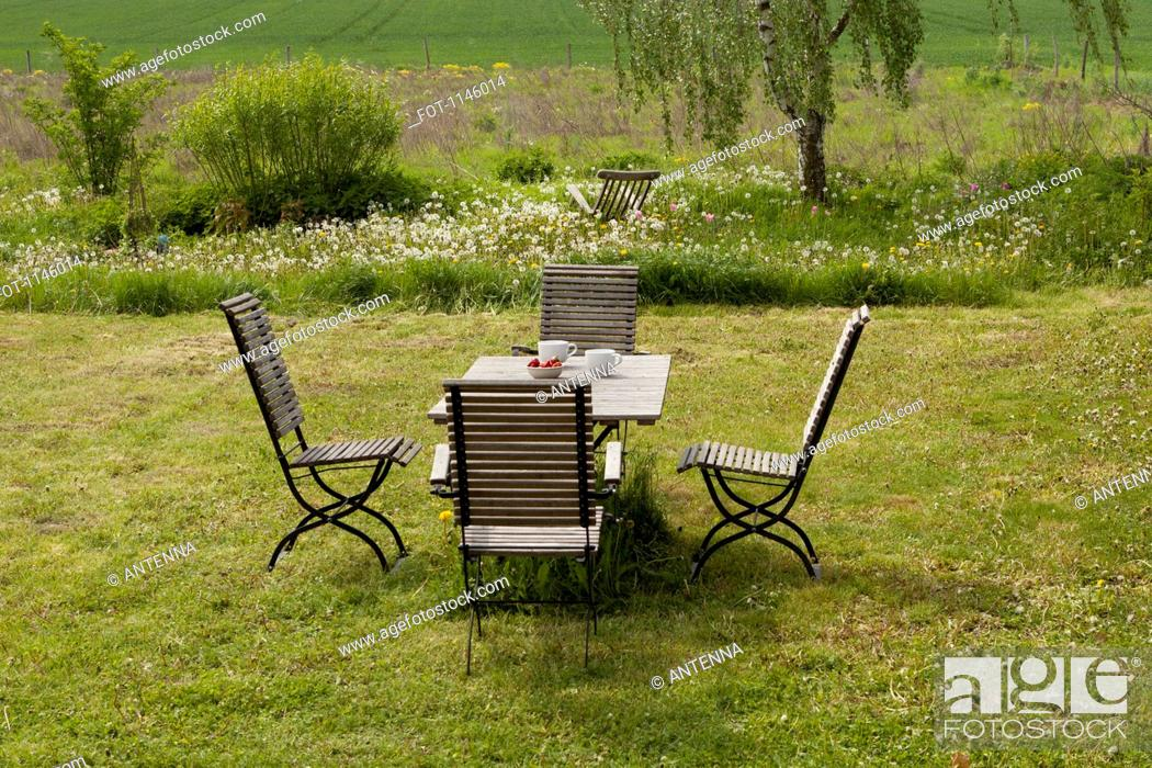 Stock Photo: An outdoor table and chairs set for breakfast.
