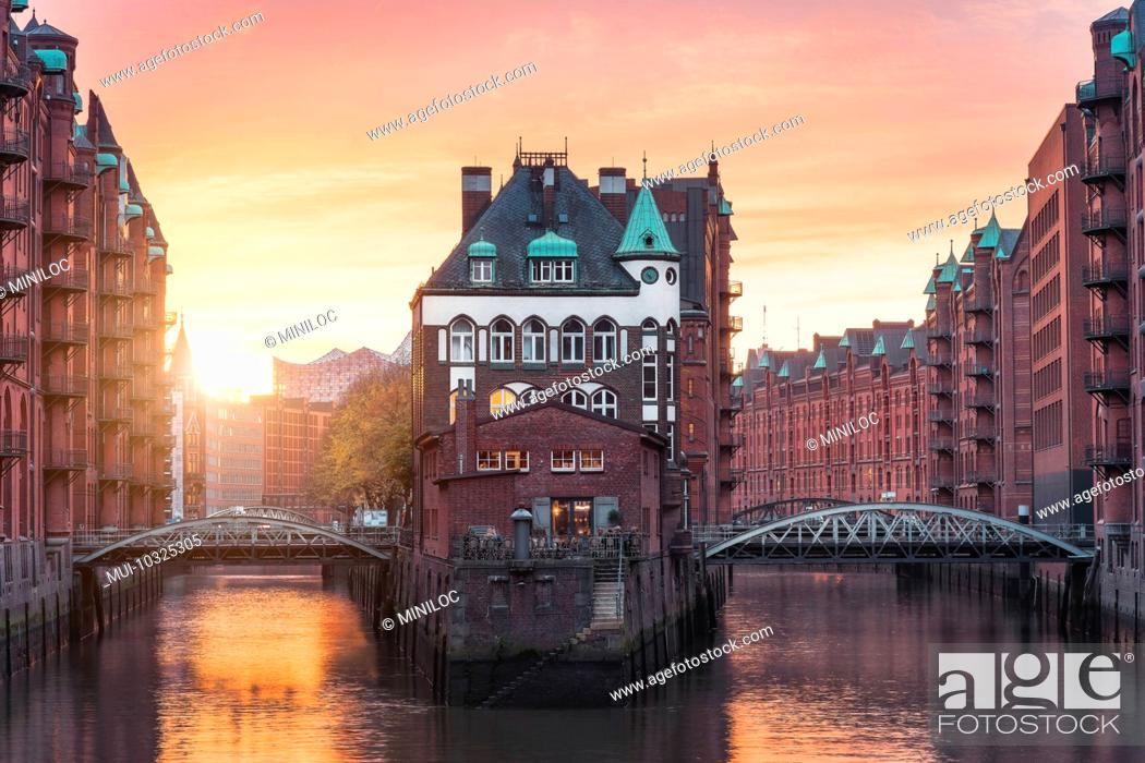Stock Photo: Hamburg Old Port, Germany, Europe, historic warehouse district with moated palace in the golden light of sunset.