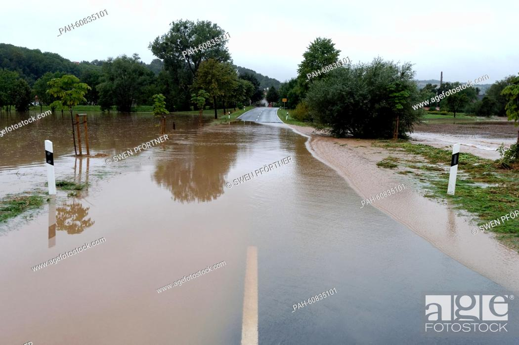 Stock Photo: The federal road B27 is flooded with rain water near Friedland, Germany, 17 August 2015. Several roads are closed after heavy rain showers during the night.