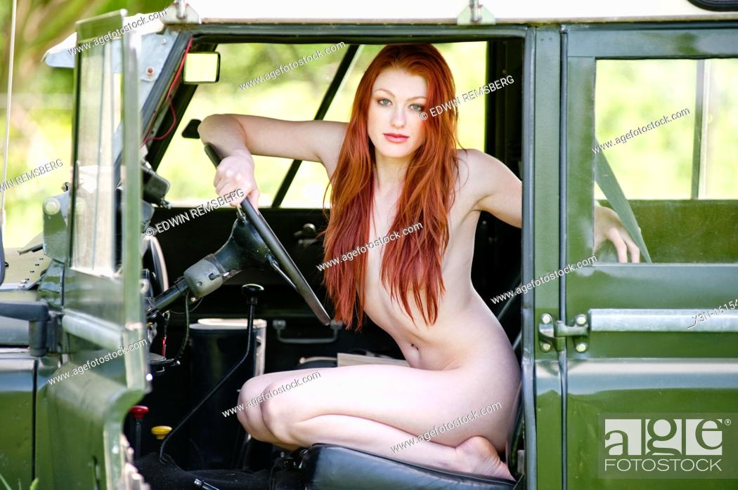 Stock Photo: Nude female in Series Land Rover.