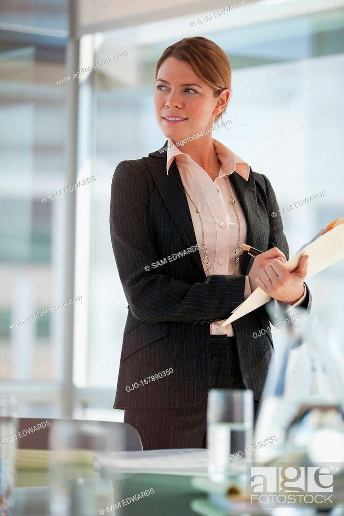 Stock Photo: Businesswoman writing in office.