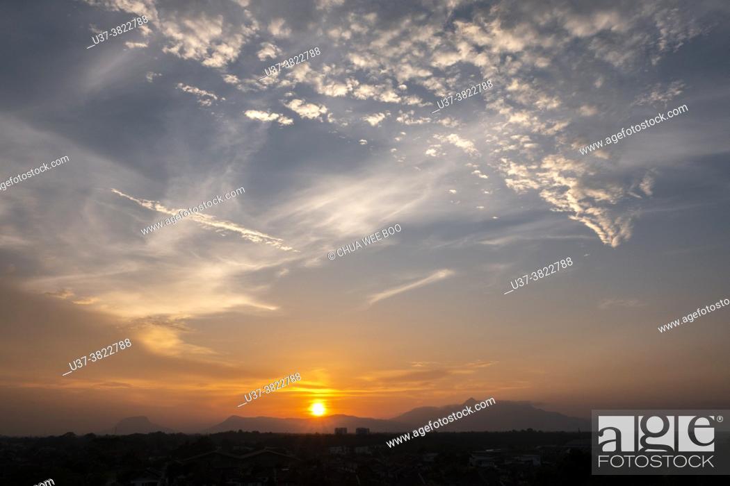 Stock Photo: Sunset over Gunung Serapi, Matang, Sarawak, East Malaysia.