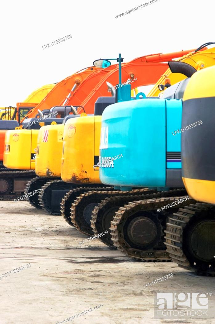 Stock Photo: Diggers for sale on auction yard.