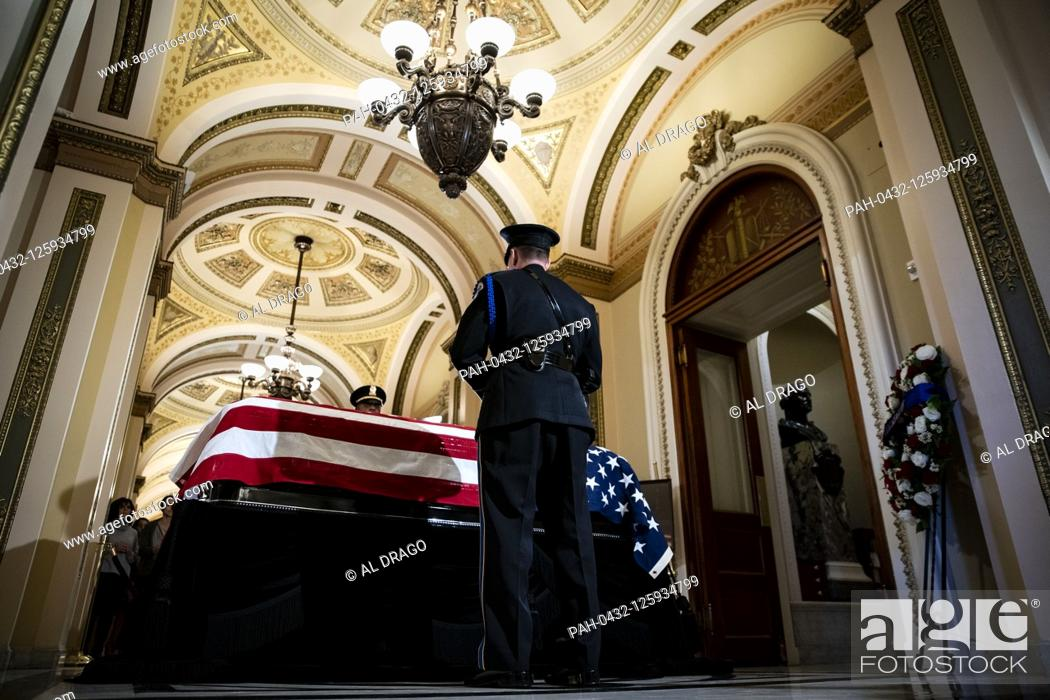 Stock Photo: A Capitol Police honor guard stands watch over the casket of late United States Representative Elijah Cummings (Democrat of Maryland) outside the House Chamber.