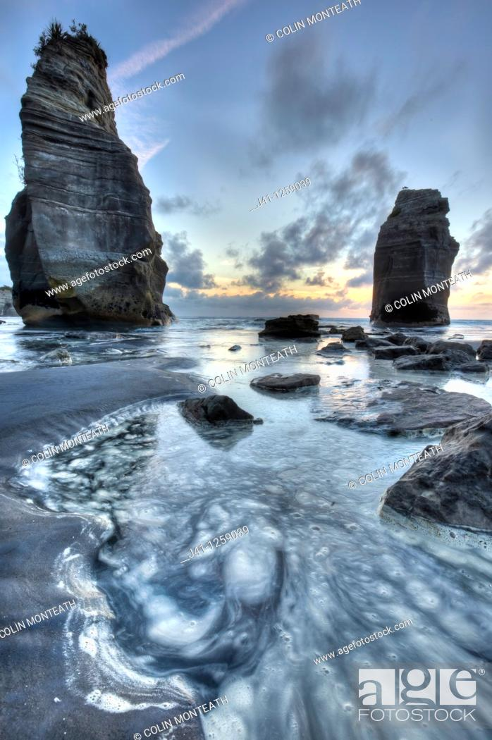 Stock Photo: Two Sisters formerly Three sisters until one rock stack fell over, sunset, Tongaporutu, North Taranaki.