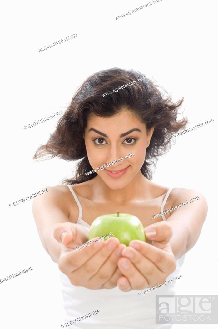 Stock Photo: Portrait of a woman holding a green apple.