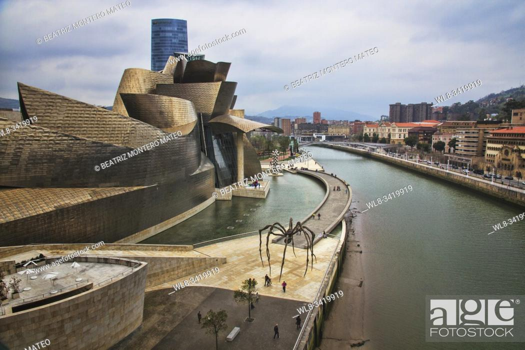 Stock Photo: Guggenheim Museum in Bilbao (Basque Country, Spain) on a cloudy day.