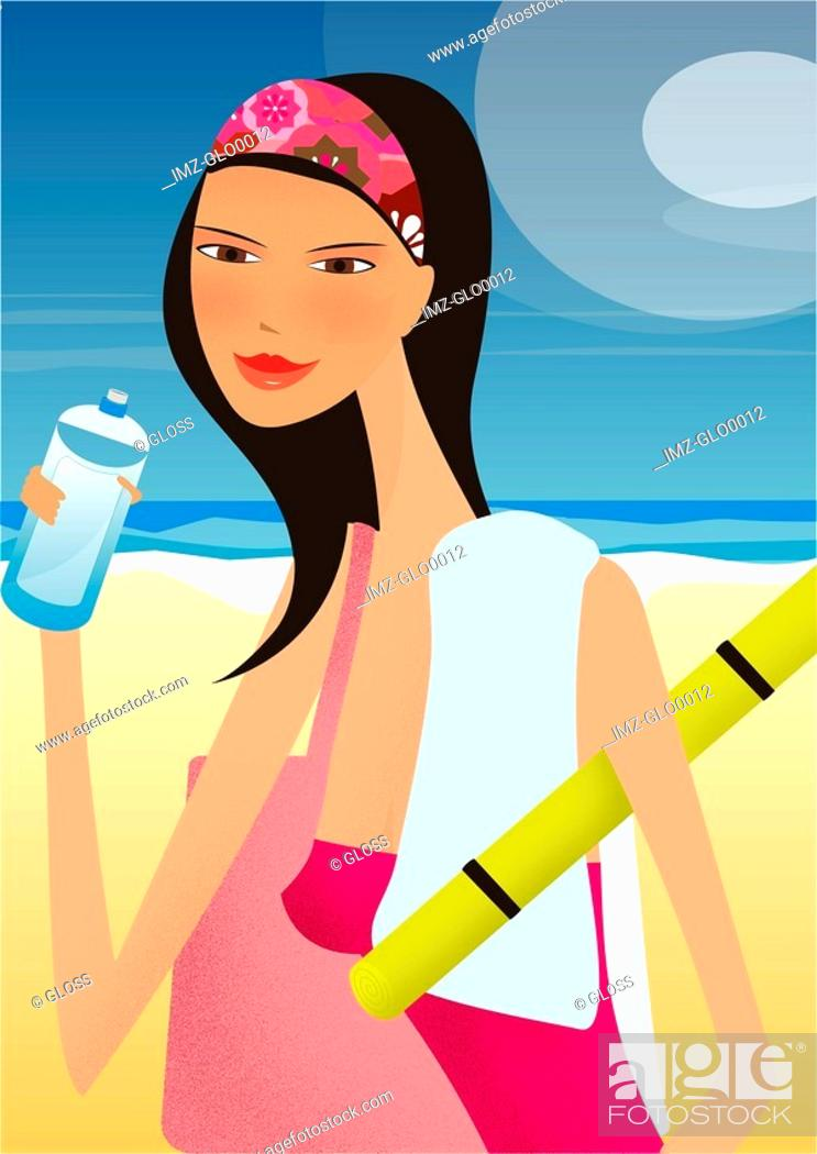 Stock Photo: A woman drinking a bottle of water at the beach.
