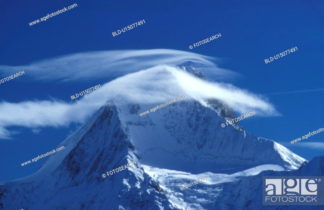 Stock Photo: Clouds on a snowy mountain top.
