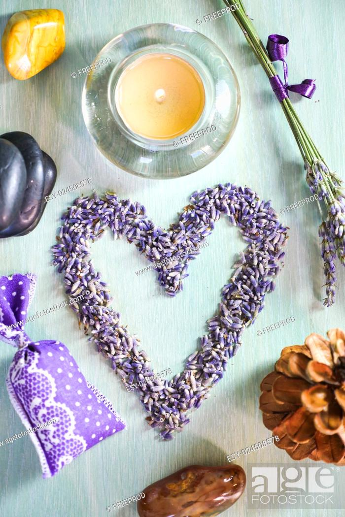 Stock Photo: Candles with heart lavender flowers on table, France, Europe.
