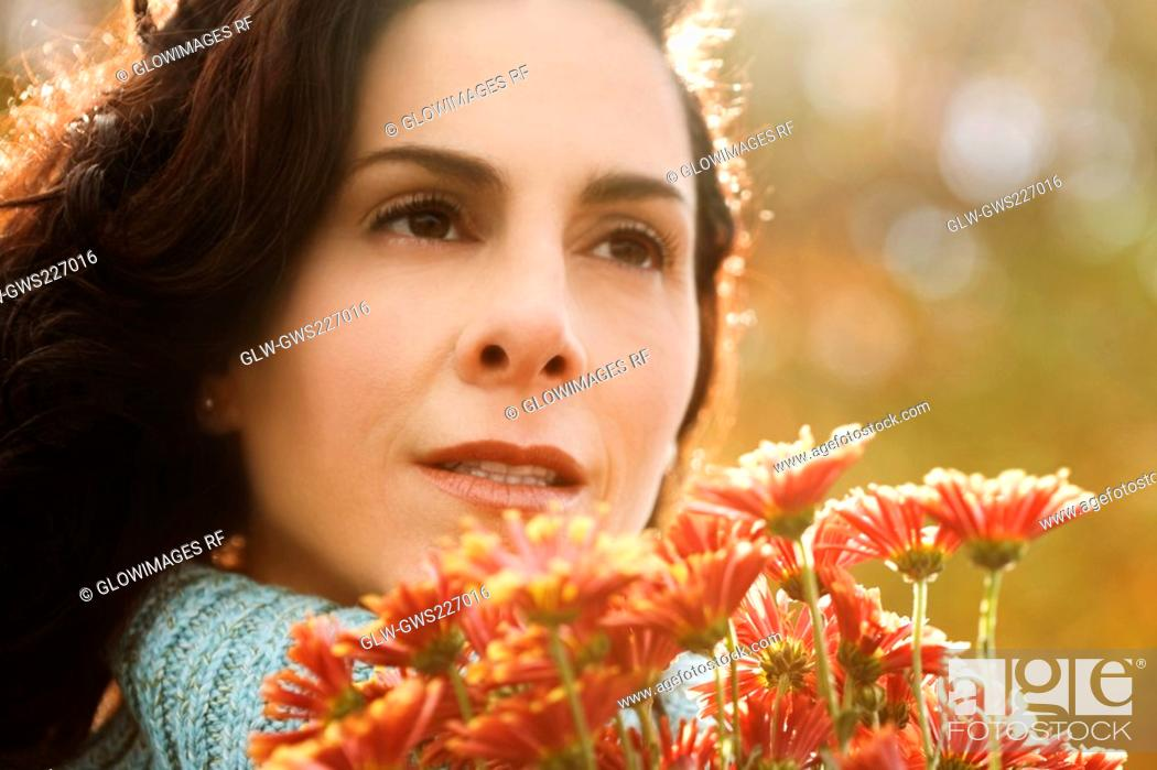 Stock Photo: Close-up of a mature woman holding a bunch of flowers.