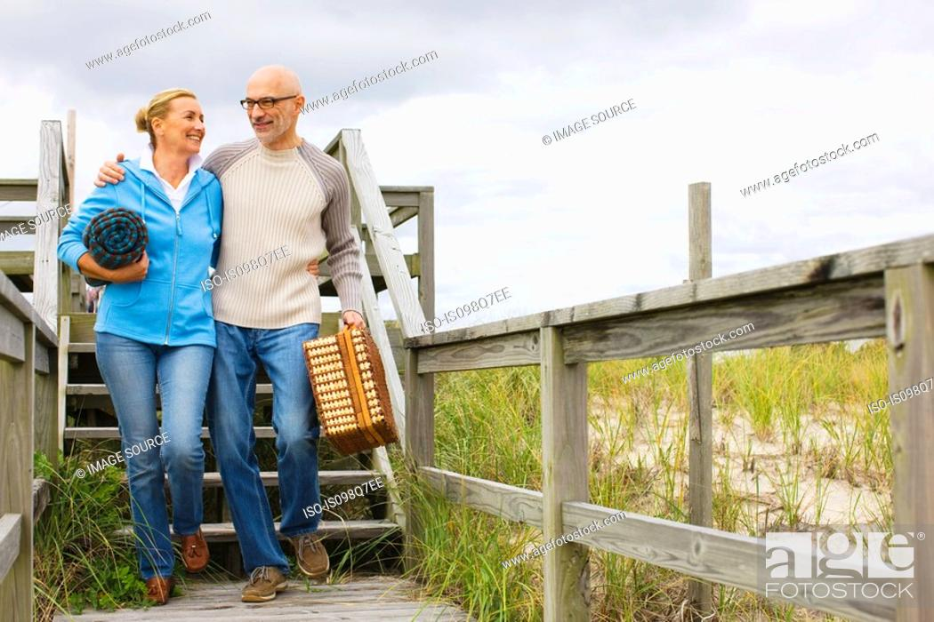 Stock Photo: Couple going for picnic.