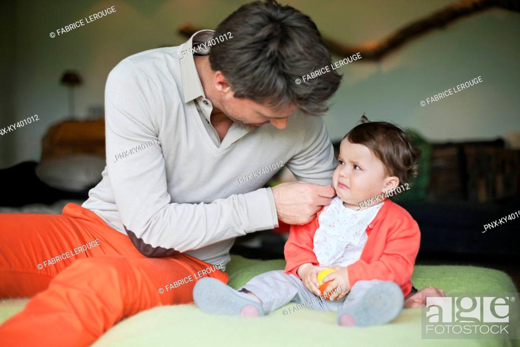 Stock Photo: Man consoling his crying daughter.
