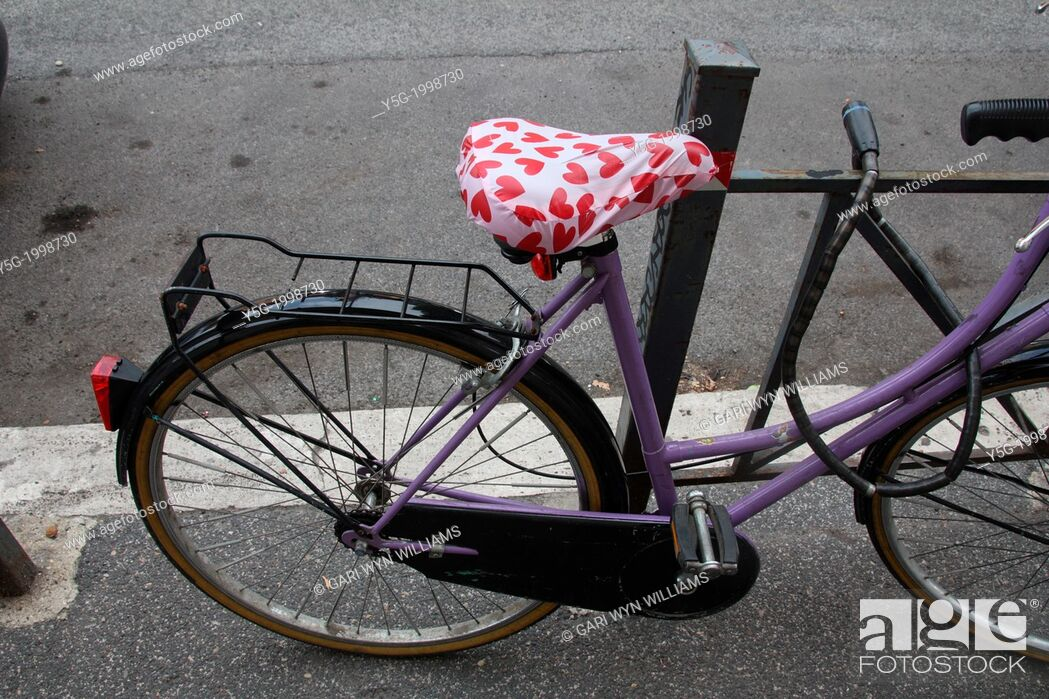 Stock Photo: bike with red love hearts saddle in road street in rome italy.