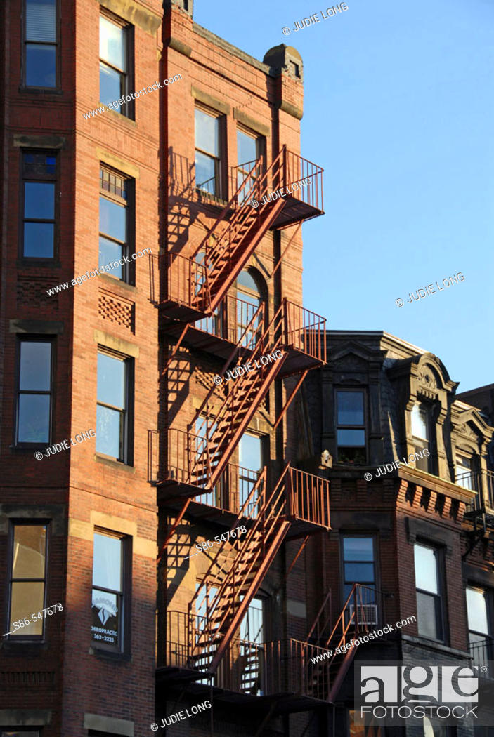 Stock Photo: Fire escape, late afternoon sun, on a Boston's Back Bay townhouse. USA.