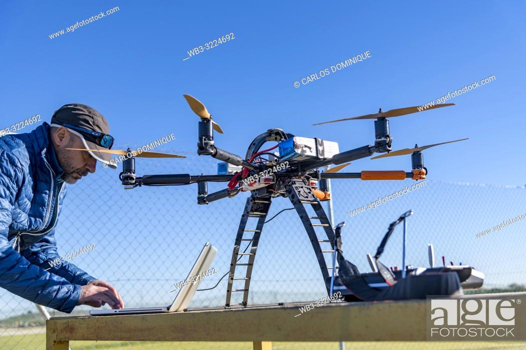 Stock Photo: Professional drone before a flight being configured by operator.