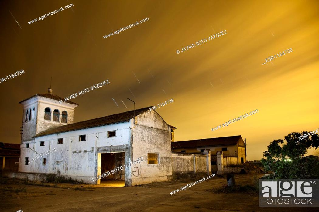 Stock Photo: Farm house at night with starry skies and.