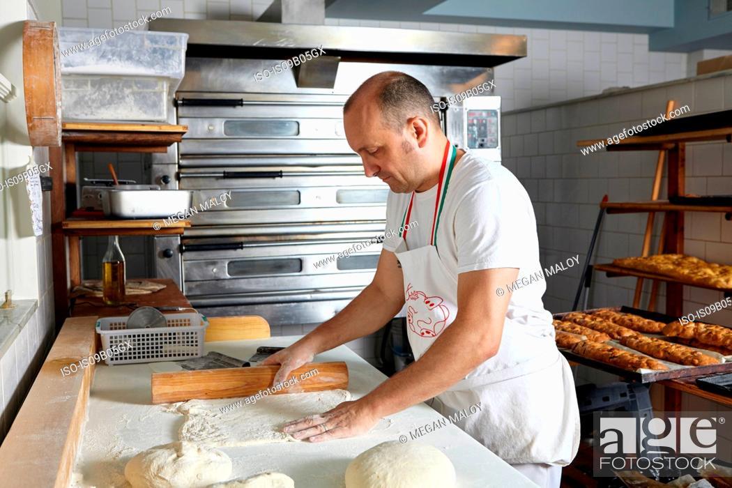 Stock Photo: Baker working in bakery.