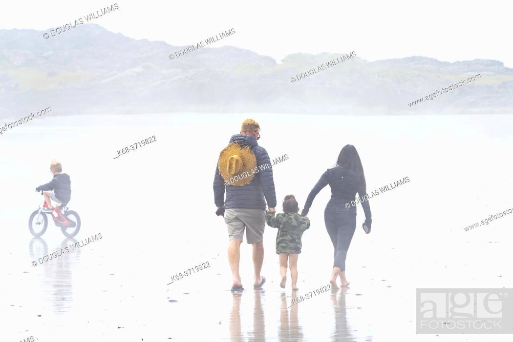 Stock Photo: family in the fog on the beach near Tofino, British Columbia, Canada.
