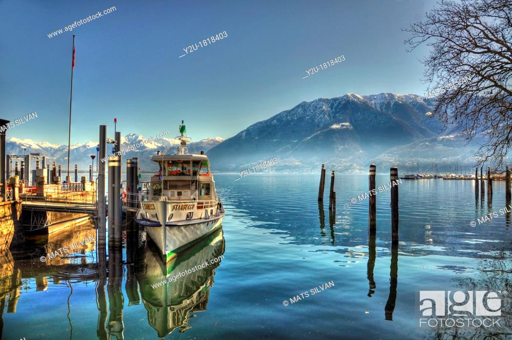 Photo de stock: Passenger ship on an alpine lake with snow-capped mountain.